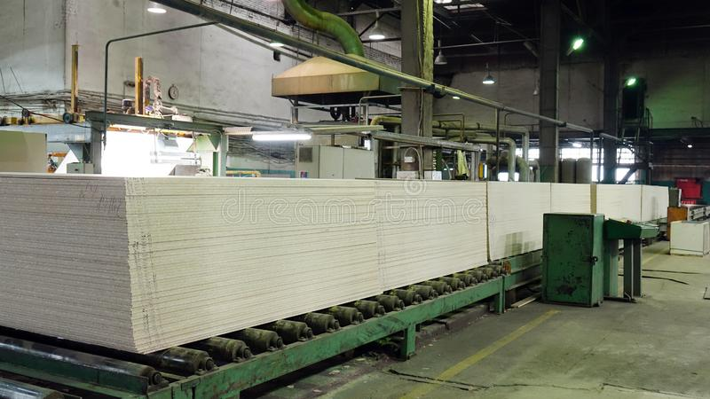 Production of laminated fiberboard. Fibreboard sheets for furniture production stock image