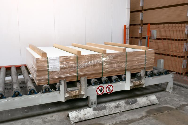 Production of laminated fiberboard. Fibreboard sheets for furniture production stock images