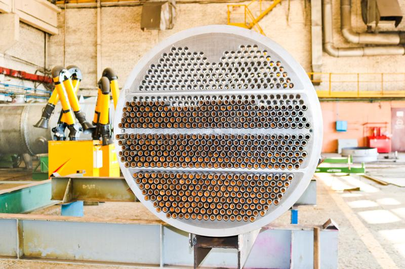 Production of a large tube bundle for a shell-and-tube heat exchanger in an industrial production room of a shop with equipment royalty free stock photography