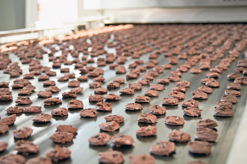 Production line of baking cookies stock photography