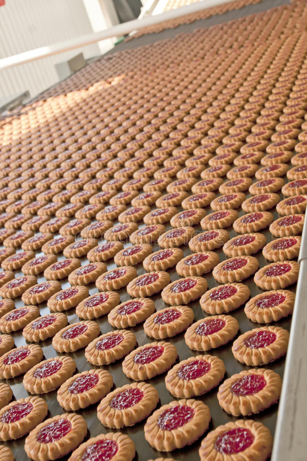 Production line of jam cookies stock images
