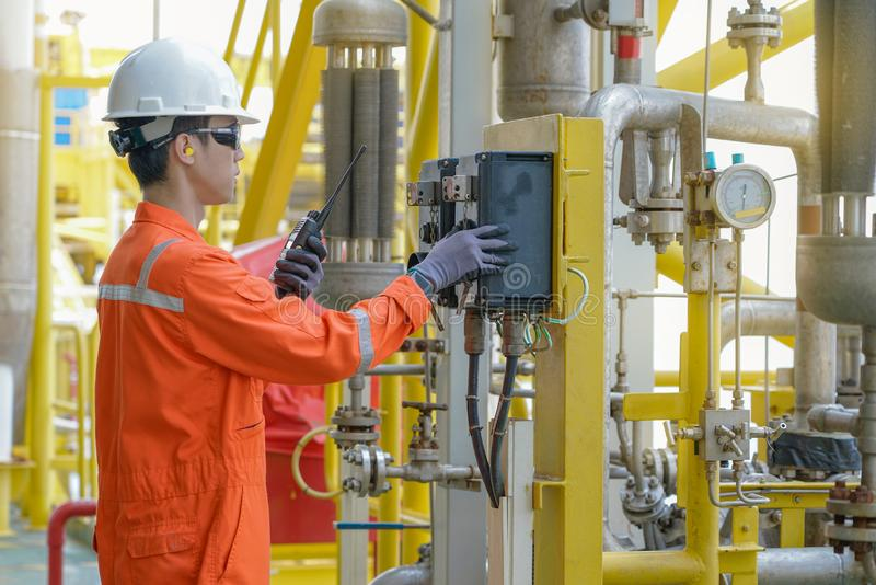 Production operator operating centrifugal oil pump by using local mode to start the pump. Production operator operating centrifugal oil pump by using local mode stock image