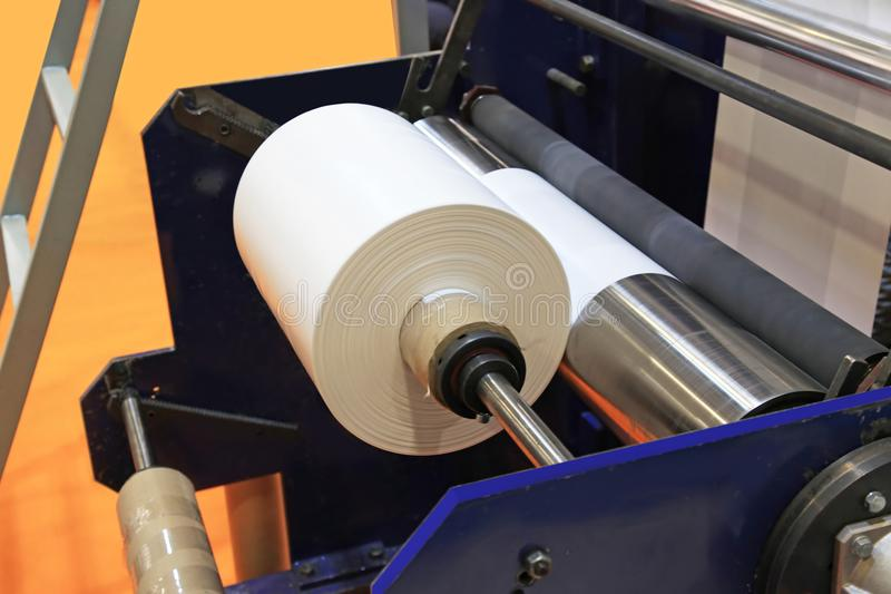 Production plastic bag. Extruder of polyethylene for process production of plastic bags royalty free stock photos