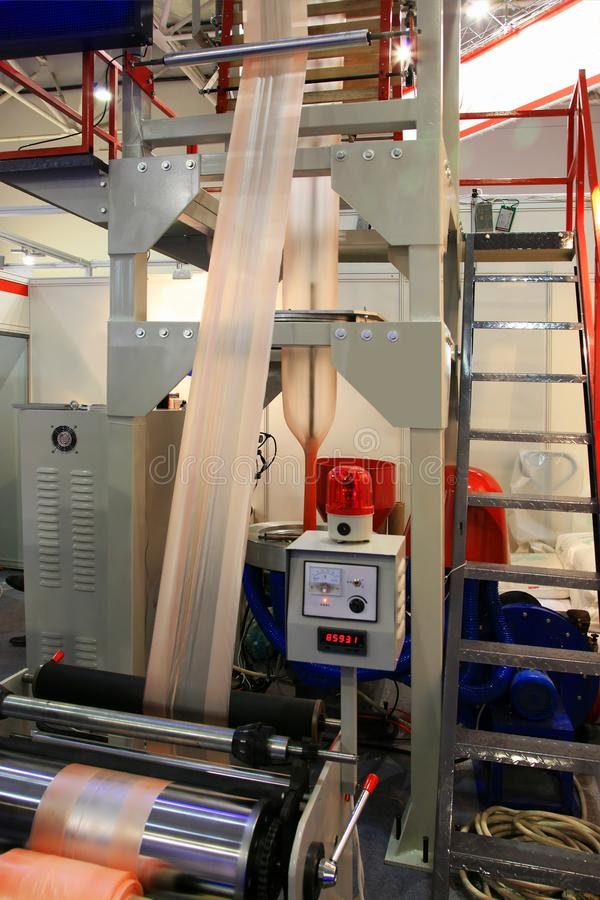 Production plastic bag. Extruder of polyethylene for process production of plastic bags stock image