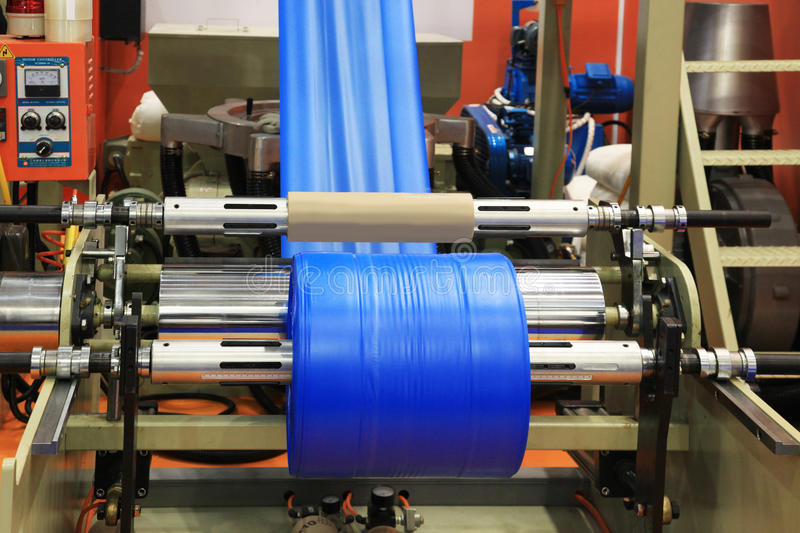 Production plastic bag. Extruder of polyethylene for process production of plastic bags royalty free stock images