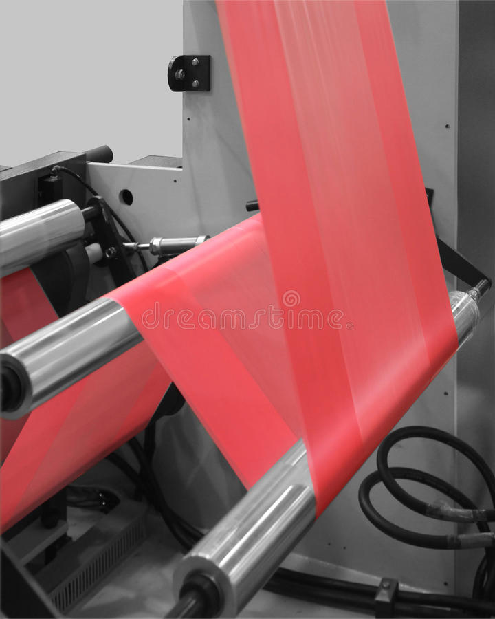 Production of plastic bags. Extruder of polyethylene for process production of plastic bags royalty free stock photography