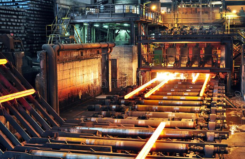 Production of steel in a steel mill - production in heavy industry stock photos
