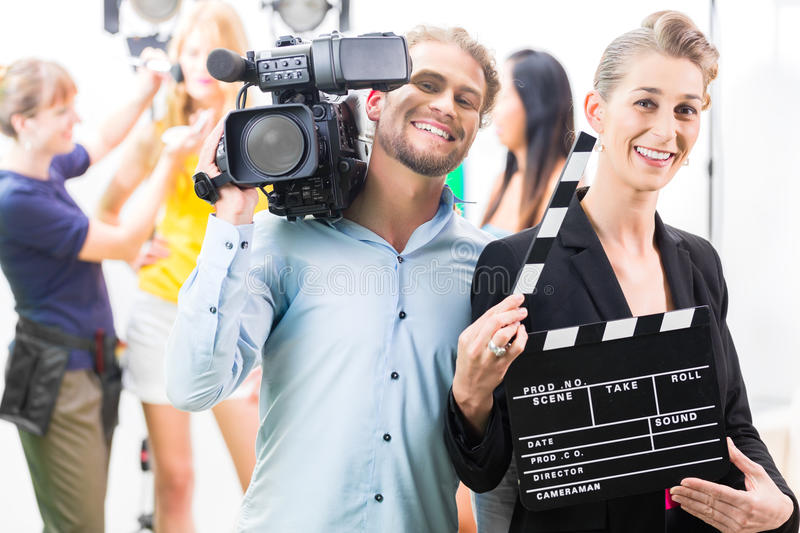 Production team with camera and take clap on film set or studio. Team or Cameraman with camera and women with take clap or board on Film Set stock images