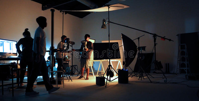 Production team shooting some video movie. stock photography