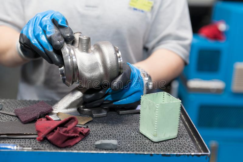 Manual work in production of vehicle part in the automotive industry. Production of car parts in the automotive industry stock image