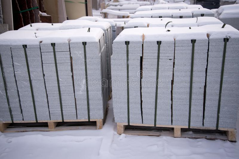 Production workshop, factory for processing natural stone granite, marble. Finished goods warehouse. Products, plates of marble. Production of marble for the stock photos