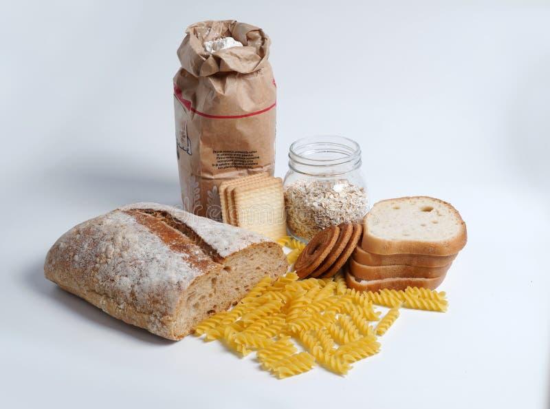 Productos de la harina de trigo con el gluten Harina, pastas, galletas, harina de avena fotos de archivo libres de regalías