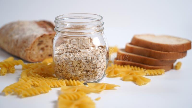 Productos de la harina de trigo con el gluten Pastas, pan, harina de avena foto de archivo libre de regalías
