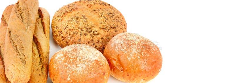Productos del pan y de la panader?a aislados en el fondo blanco Espacio libre para el texto Foto ancha foto de archivo libre de regalías