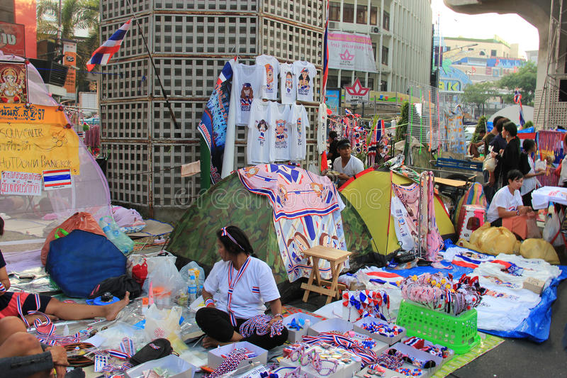 Products for Anti-Government Protesters. Bangkok, Thailand - January 26, 2014: Many products with Thailand Flag colors and protester's leaders pictures are sold stock photography