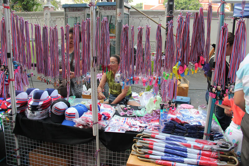 Products for Anti-Government Protesters. Bangkok, Thailand - January 26, 2014: Many products with Thailand Flag colors and protester's leaders pictures are sold stock photo