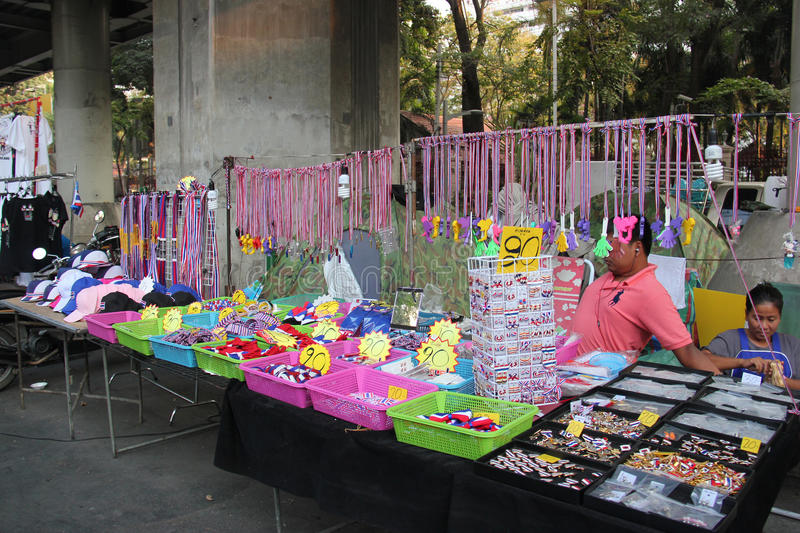 Products for Anti-Government Protesters. Bangkok, Thailand - January 26, 2014: Many products with Thailand Flag colors and protester's leaders pictures are sold royalty free stock photography