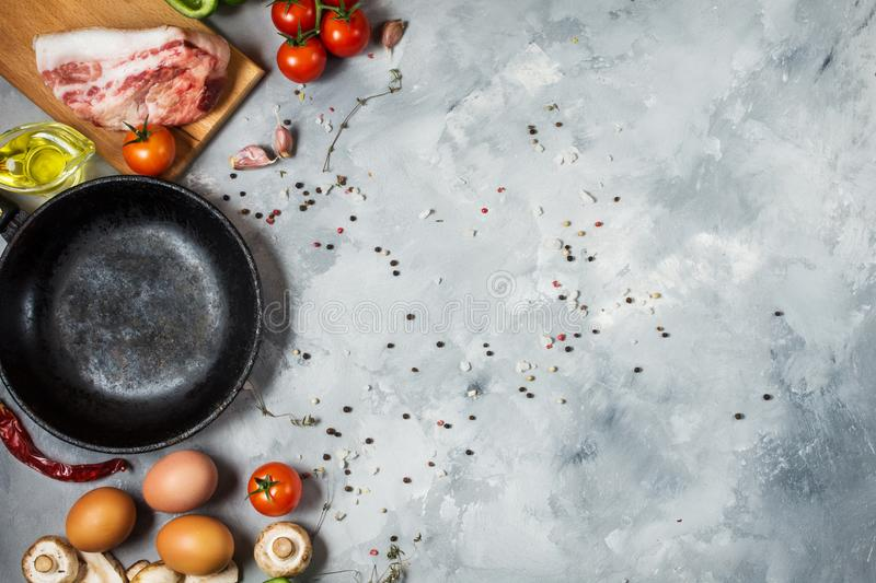 Products for breakfast, eggs, bacon, vegetables, herbs on stone background, top view with copy space. stock photos
