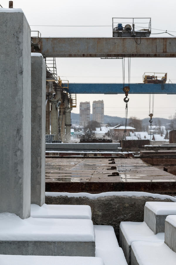 Products from concrete in a warehouse. Products from concrete in a factory warehouse during snowfall stock images