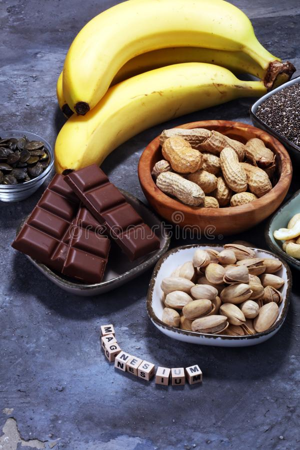Products containing magnesium: bananas, pumpkin seeds, cashew nu. Ts, peanuts, pistachios, dark chocolate and sesame seeds royalty free stock photography