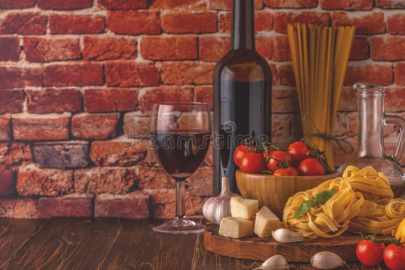 Products for cooking - pasta, tomatoes, garlic, olive oil and re stock photo