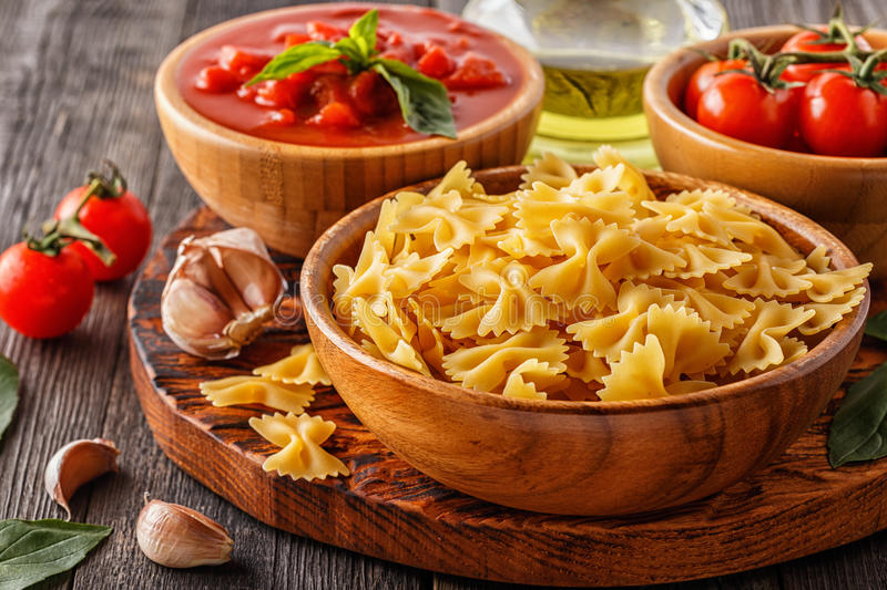 Products for cooking - pasta, tomatoes, garlic, olive oil royalty free stock images