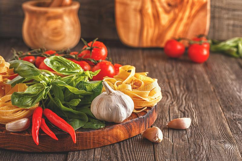 Products for cooking - pasta, tomatoes, garlic, pepper, and basi royalty free stock photos