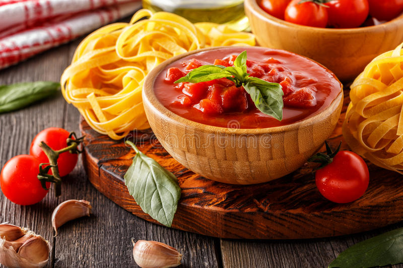Products for cooking - tomato sauce, pasta, tomatoes, garlic stock photo