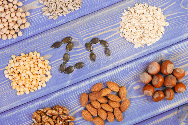 Products and ingredients containing zinc and dietary fiber, healthy nutrition. Inscription Zn, ingredients or products containing zinc and dietary fiber, natural royalty free stock image