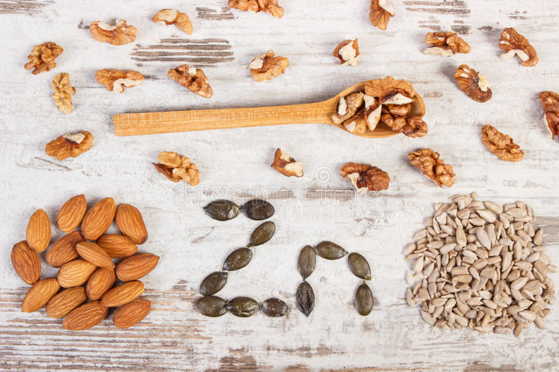 Products and ingredients containing zinc and dietary fiber, healthy nutrition. Inscription Zn, ingredients or products containing zinc and dietary fiber on old royalty free stock photos