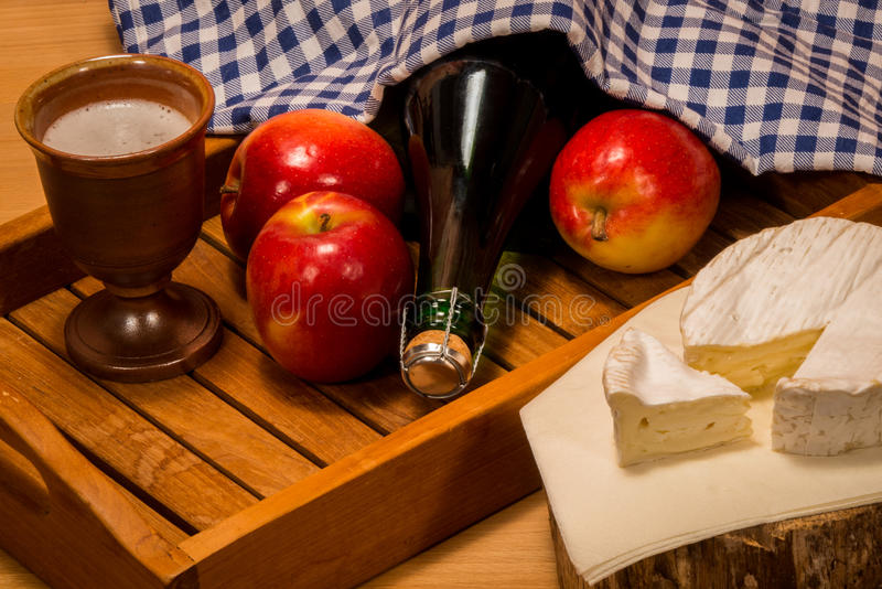 Products from normandy. Typical specialties and delicacies from france apples Camenbert and Cidre cider royalty free stock photo
