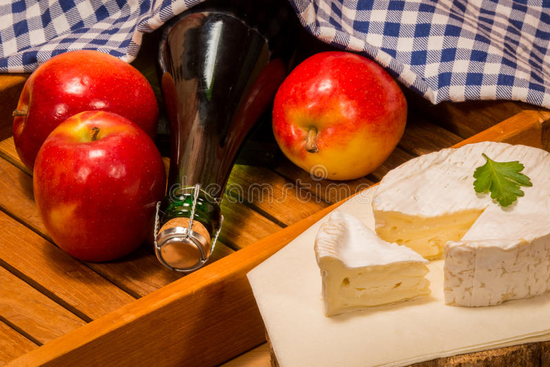 Products from normandy. Typical specialties and delicacies from france apples Camenbert and Cidre cider royalty free stock images