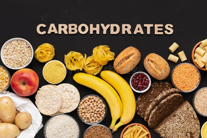 Healthy food with carbohydrates on black background royalty free stock photography