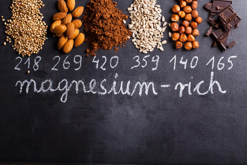 Products rich in magnesium. On black background royalty free stock photos
