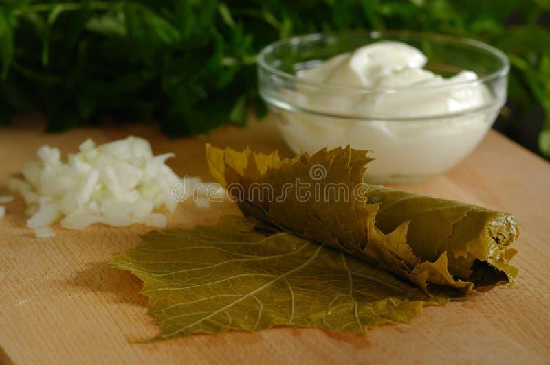 Products for sarma (dolmadakia). Preparation of sarma (dolmadakia) - grape leaves stuffed with rice stock photography