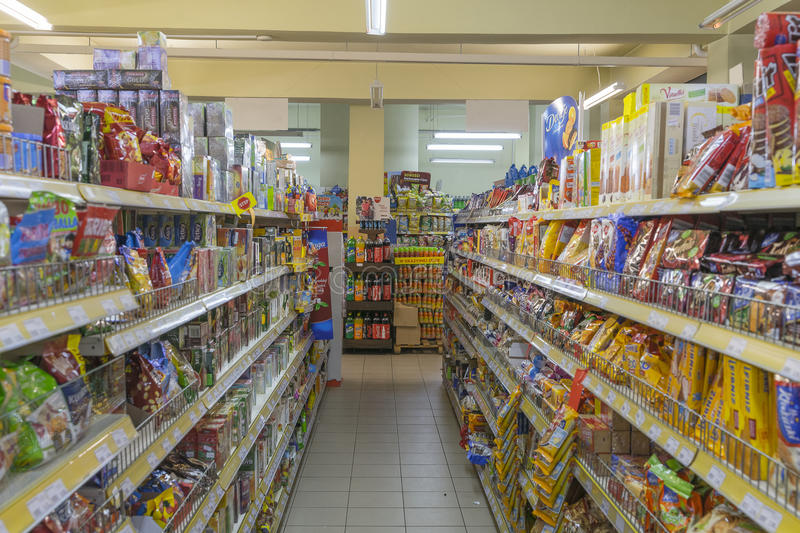 Products on store shelves. Different products stand in a row on the store shelves.Small market in Kraków , Poland stock image
