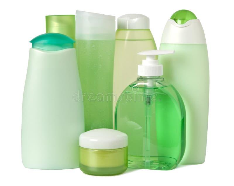 Produits de beauté dans des conteneurs verts photos stock