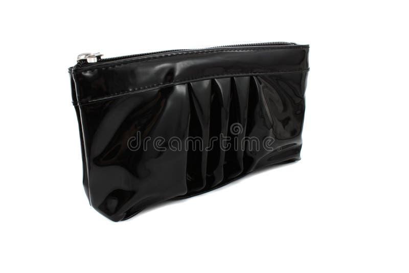 Produits de beauté de sac à main photographie stock libre de droits
