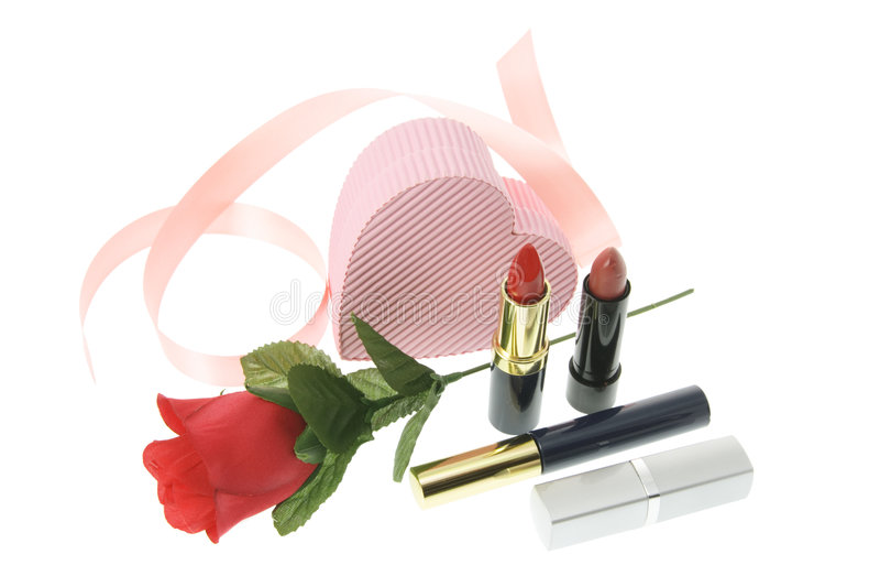 Produits de beauté et Rose rouge photos libres de droits