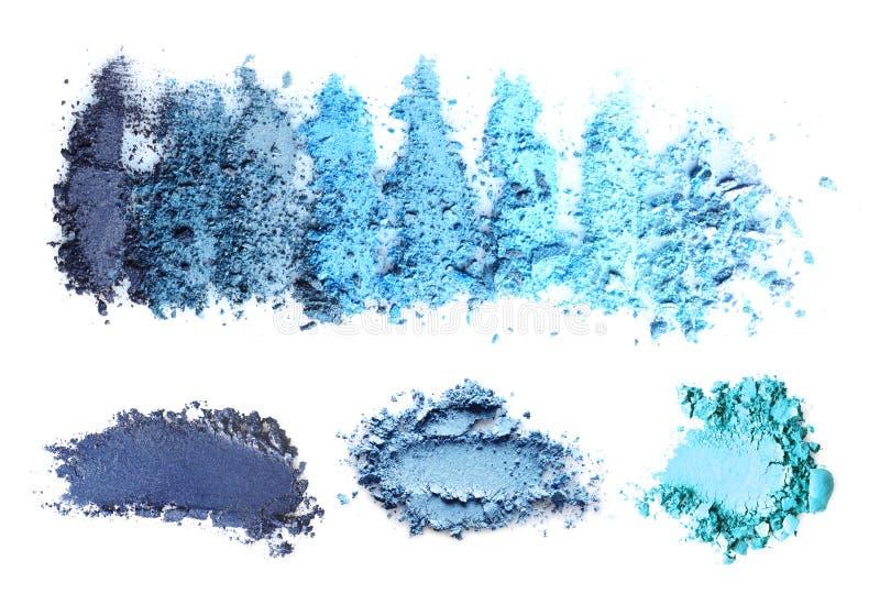 Produits de maquillage écrasés sur le fond blanc photos stock