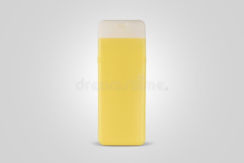 Produto cosmético para o champô Pacote amarelo do produto imagens de stock royalty free