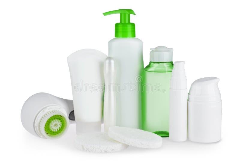 Produtos do cuidado e de beleza do corpo isolados no fundo branco imagens de stock