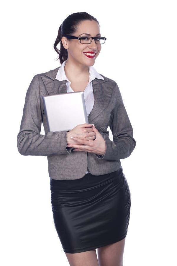 Profesional femenino del asunto que usa la PC de la tablilla imagen de archivo libre de regalías
