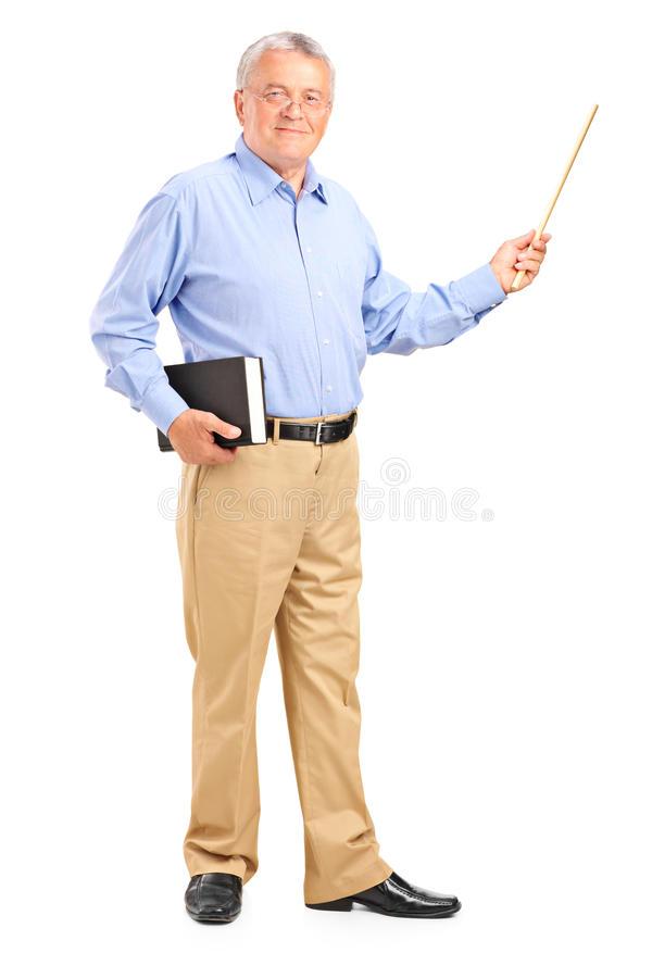Profesor de sexo masculino que sostiene una varita y un libro imágenes de archivo libres de regalías