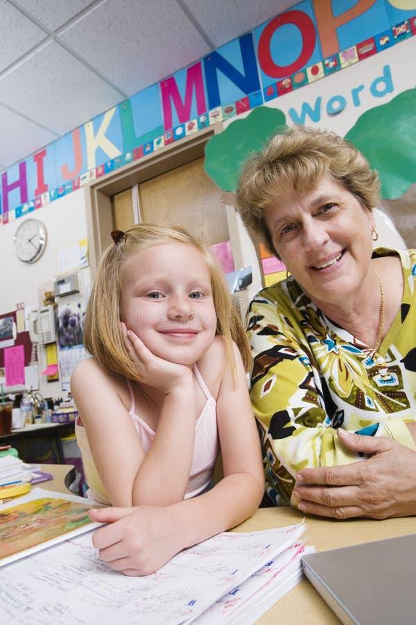 Profesor With Elementary Student fotografía de archivo
