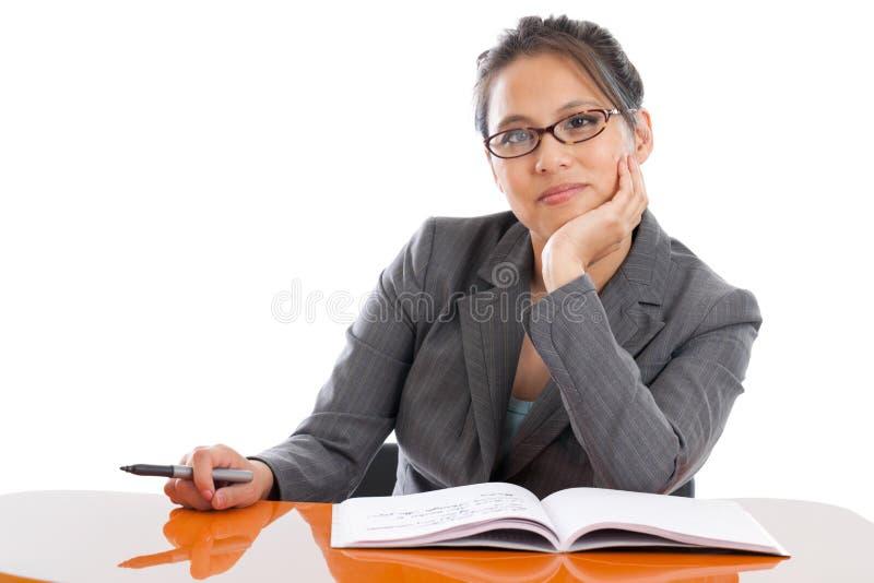 Profesor en un escritorio fotos de archivo