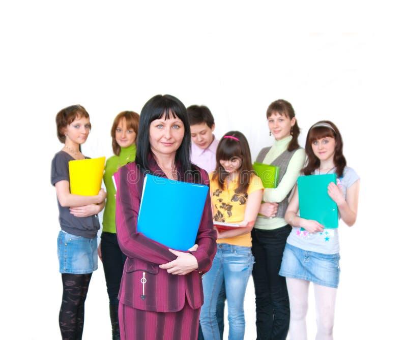 Profesor ocasional y sus estudiantes sobre blanco fotografía de archivo