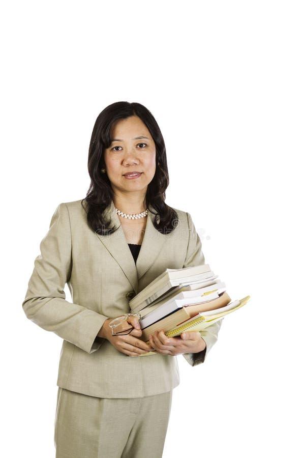 Profesor ocupado de la mujer foto de archivo