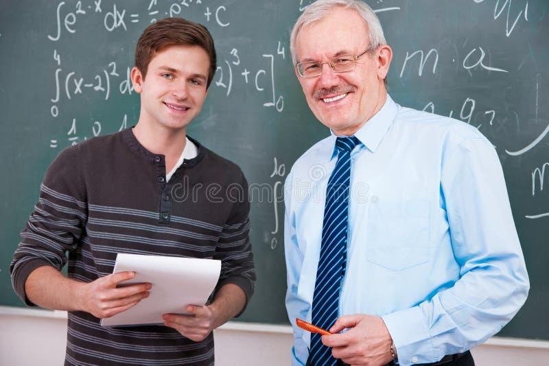 Profesor y estudiante imagenes de archivo