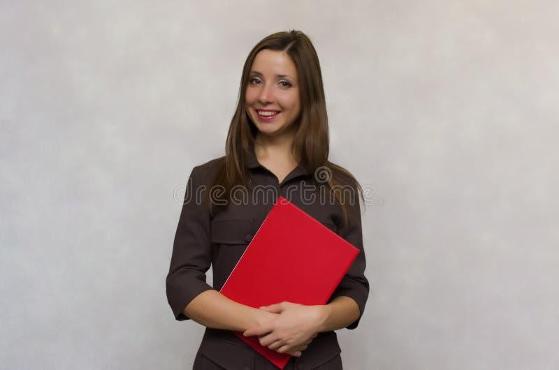 Professeur avec un journal de classe secrétaire photo stock